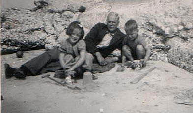 Grandpa with grandkids on the beach